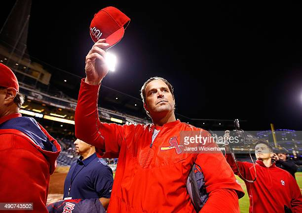 Manager Mike Matheny of the St Louis Cardinals tips his cap to the crowd following their 111 win against the Pittsburgh Pirates that clinched the...