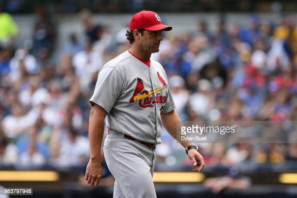 Manager Mike Matheny of the St Louis Cardinals walks across the field in the seventh inning against the Milwaukee Brewers at Miller Park on June 23...