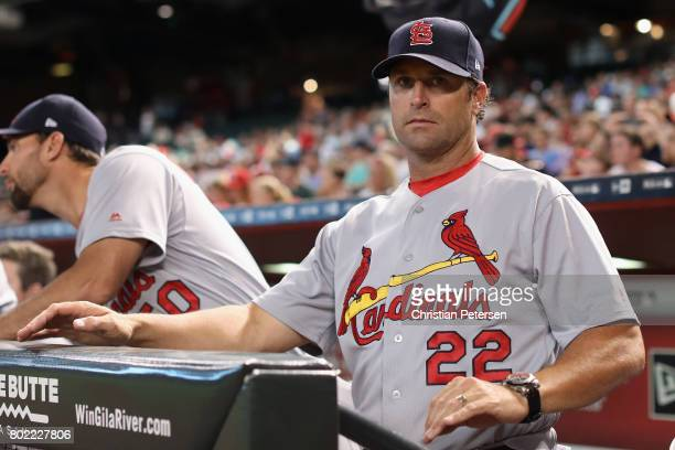 Manager Mike Matheny of the St Louis Cardinals watches from the dugout during the MLB game against the Arizona Diamondbacks at Chase Field on June 27...
