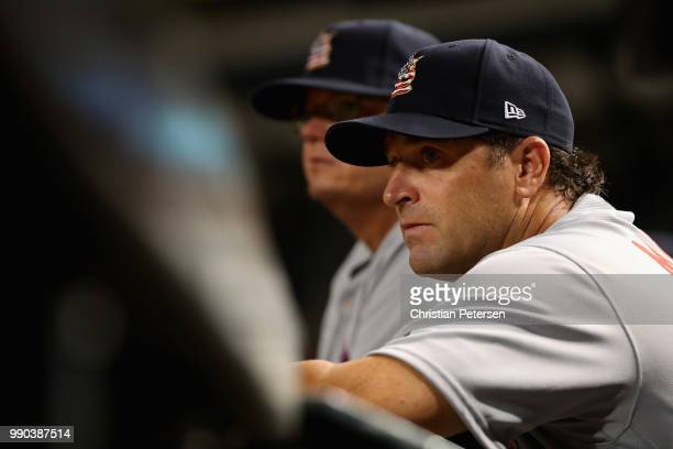 Manager Mike Matheny of the St Louis Cardinals watches from the dugout during the sixth inning of the MLB game against the Arizona Diamondbacks at...