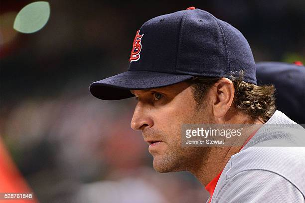 Manager Mike Matheny of the St Louis Cardinals watches the game against the Arizona Diamondbacks from the bench at Chase Field on April 26 2016 in...