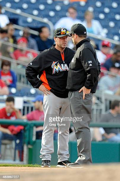Manager Mike Redmond of the Miami Marlins argues a call with third base umpire Dan Bellino in the fourth inning against the Washington Nationals at...