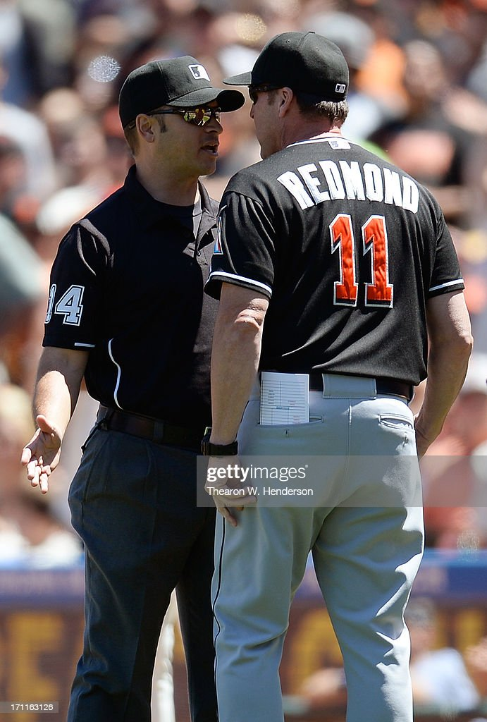 Manager Mike Redmond #11 of the Miami Marlins argues with first base umpire Mark Wegner #14 over a ground rule double call that allowed Barry Zito #75 of the San Francisco Giants to score from first base in the fifth inning at AT&T Park on June 22, 2013 in San Francisco, California.