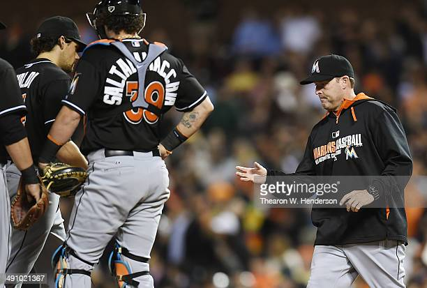 Manager Mike Redmond of the Miami Marlins comes out to take the ball from starting pitcher Nathan Eovaldi taking Eovaldi out of the game against the...