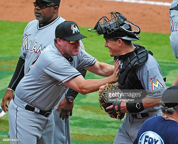 Manager Mike Redmond of the Miami Marlins playfully shoves Catcher J T Realmuto after the game against the Atlanta Braves at Turner Field on April 15...