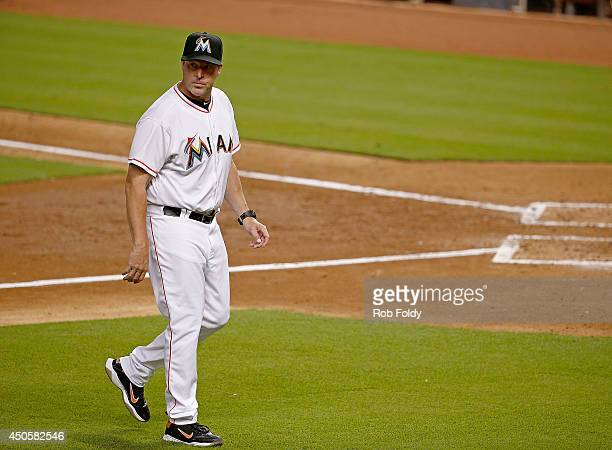 Manager Mike Redmond of the Miami Marlins returns to the dugout during the game against the Pittsburgh Pirates at Marlins Park on June 13 2014 in...