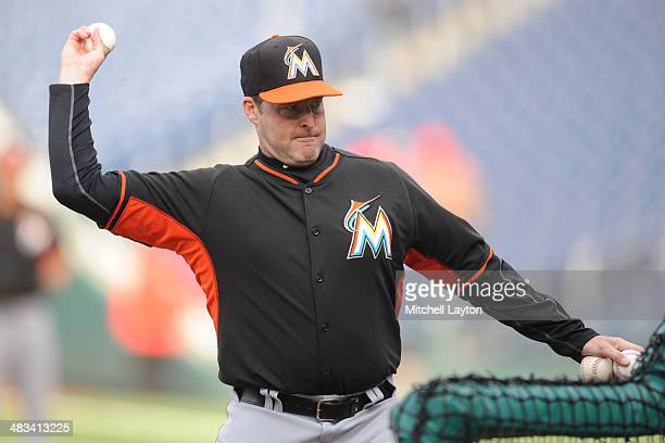 Manager Mike Redmond of the Miami Marlins throws batting practice before a baseball against the Washington Nationals on April 8 2014 at Nationals...
