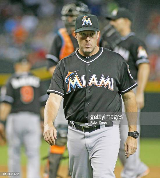 Manager Mike Redmond of the Miami Marlins walks from the mound after a pitching change during the eighth inning of a MLB game against the Arizona...