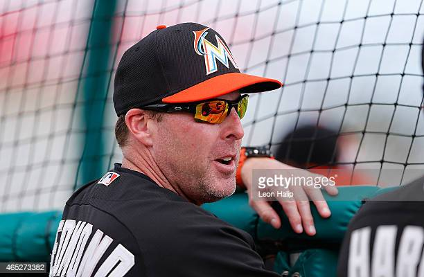 Manager Mike Redmond of the Miami Marlins watches batting practice prior to the start of the Spring Training game against the St Louis Cardinals at...