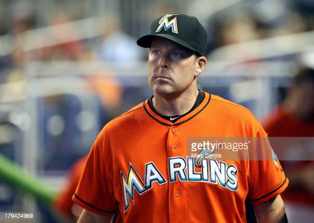 Manager Mike Redmond of the Miami Marlins watches from the duggout against the Colorado Rockies at Marlins Park on August 25 2013 in Miami Florida...