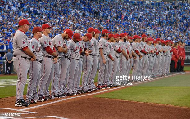 Manager Mike Scioscia and the Los Angeles Angels of Anaheim line up for the National Anthem before game 3 of the American League Division Series...