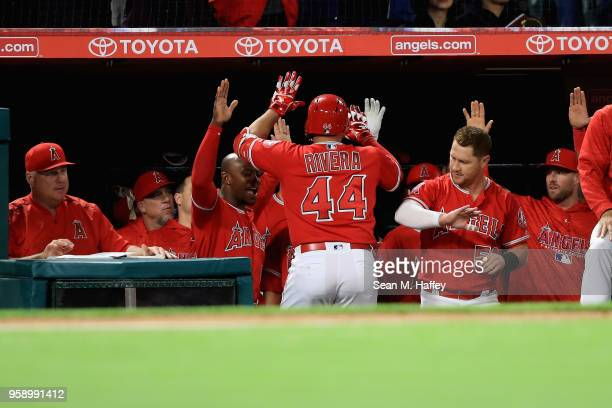 Manager Mike Scioscia Justin Upton and Kole Calhoun congratulate Rene Rivera of the Los Angeles Angels of Anaheim after his solo homerun during the...