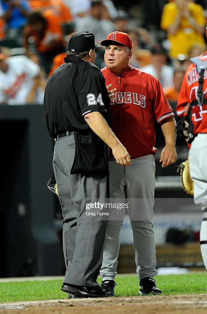 Manager Mike Scioscia of the Los Angeles Angels of Anaheim argues with home plate Umpire Jerry Layne after a called balk in the sixth inning of the game against the Baltimore Orioles at Camden Yards on August 3, 2010 in Baltimore, Maryland.