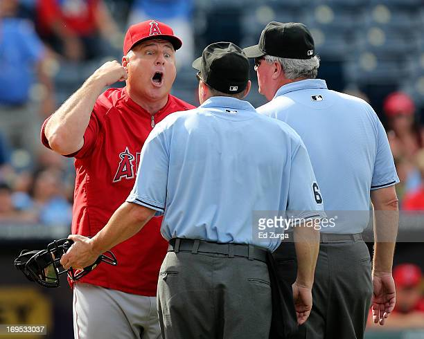 Manager Mike Scioscia of the Los Angeles Angels of Anaheim argues with plate umpire Marty Foster and Tim Welke after a third strike on Jeff Francoeur...