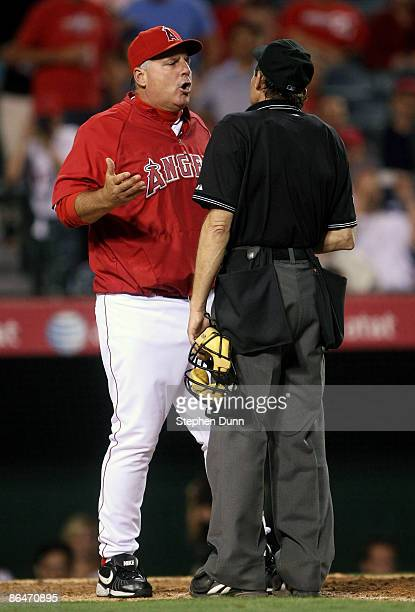 Manager Mike Scioscia of the Los Angeles Angels of Anaheim argues with home plate umpire Bill Hohn in the game with the Toronto Blue Jays at Angel...