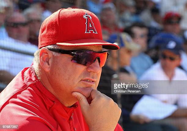 Manager Mike Scioscia of the Los Angeles Angels of Anaheim looks on during the MLB spring training game against the Kansas City Royals at Surprise...