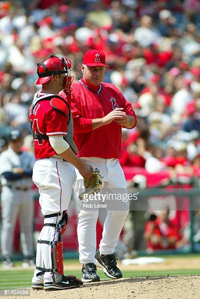 Manager Mike Scioscia of the Los Angeles Angels of Anaheim stands on the mound with Mike Napoli during the game against the Seattle Mariners at Angel...
