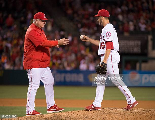 Manager Mike Scioscia of the Los Angeles Angels of Anaheim takes the ball from closing pitcher Huston Street as Street leaves the game after giving...