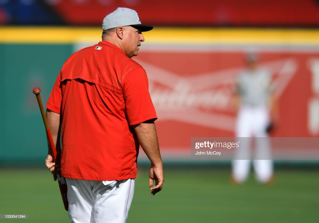 Manager Mike Scioscia of the Los Angeles Angels of Anaheim walks out to batting practice before playing the Seattle Mariners at Angel Stadium on September 14, 2018 in Anaheim, California.