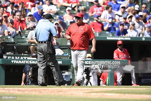 Manager Mike Scioscia of the Los Angeles Angels of Anaheim walks out on the field with a question for home plate umpire Dale Scott during the game...