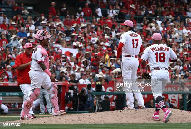Manager Mike Scioscia of the Los Angeles Angels of Anaheim walks to the mound to take pitcher Shohei Ohtani out of the game as catcher Martin...
