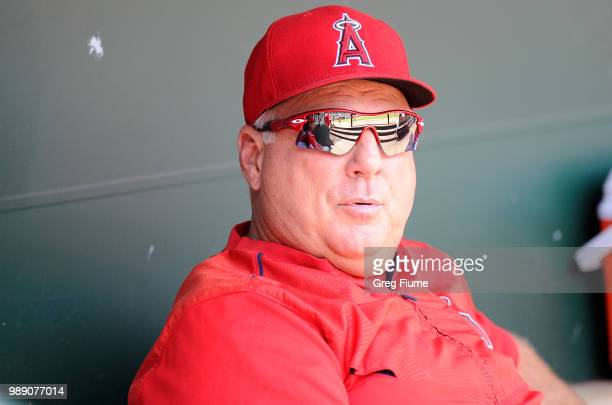 Manager Mike Scioscia of the Los Angeles Angels sits in the dugout before the game against the Baltimore Orioles at Oriole Park at Camden Yards on...
