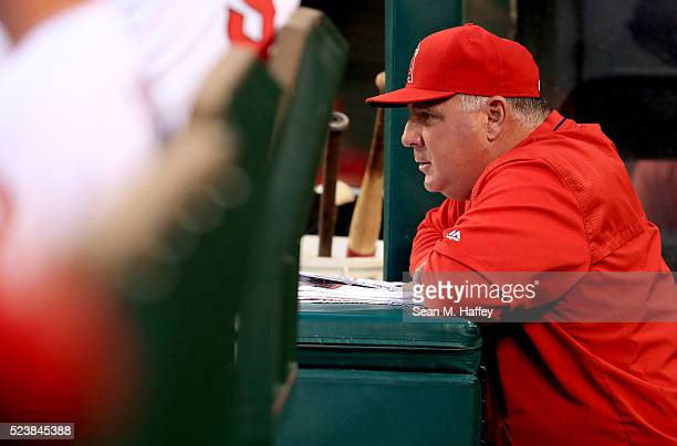 Manager Mike Scioscia of the the Los Angeles Angels of Anaheim looks on during the first inning of a baseball game between the Los Angeles Angels of...