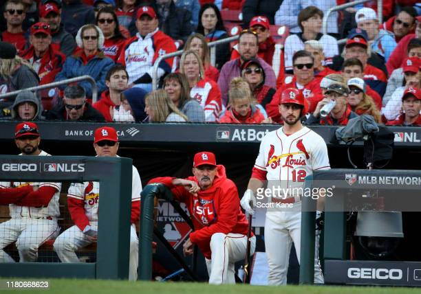 Manager Mike Shildt and Paul DeJong of the St Louis Cardinals watch the game from the dug out during the fifth inning of game two of the National...