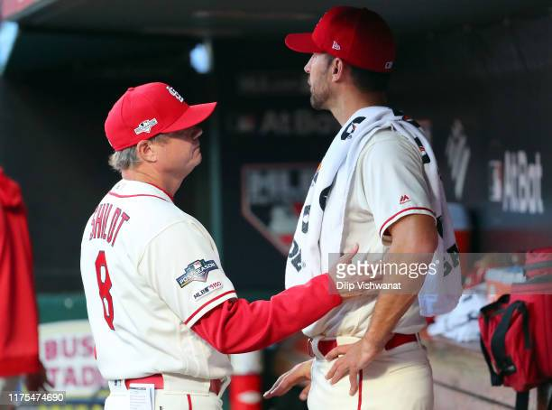 Manager Mike Shildt consoles starting pitcher Adam Wainwright of the St Louis Cardinals during Game 2 of the NLCS between the Washington Nationals...