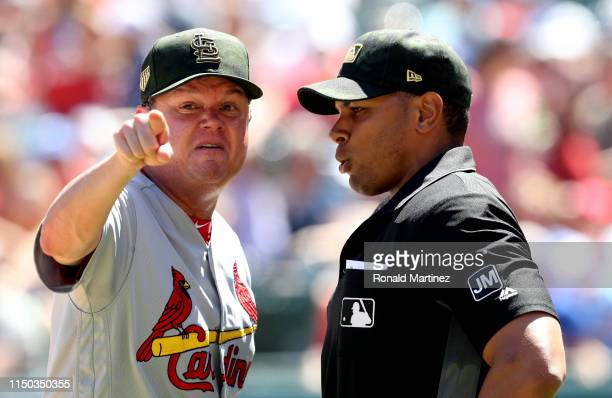 Manager Mike Shildt of the St Louis Cardinals argues a call with umpire Jeremie Rehak in the fourth inning against the Texas Rangers at Globe Life...