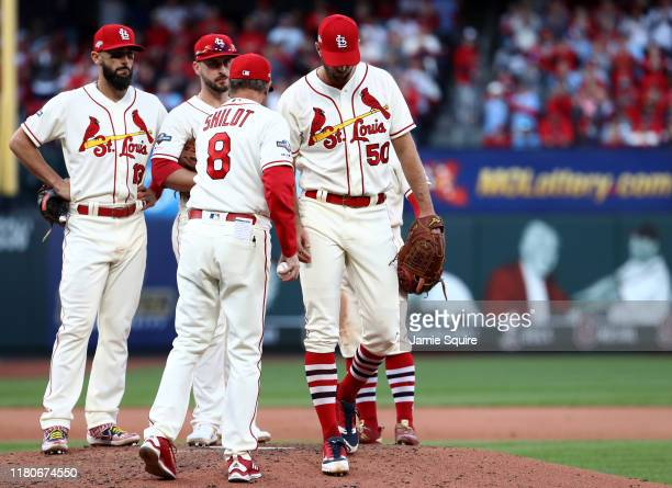 Manager Mike Shildt of the St Louis Cardinals pulls Adam Wainwright in the inning of game two of the National League Championship Series against the...