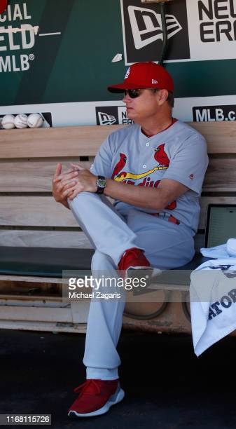 Manager Mike Shildt of the St Louis Cardinals sits in the dugout prior to the game against the Oakland Athletics at the OaklandAlameda County...