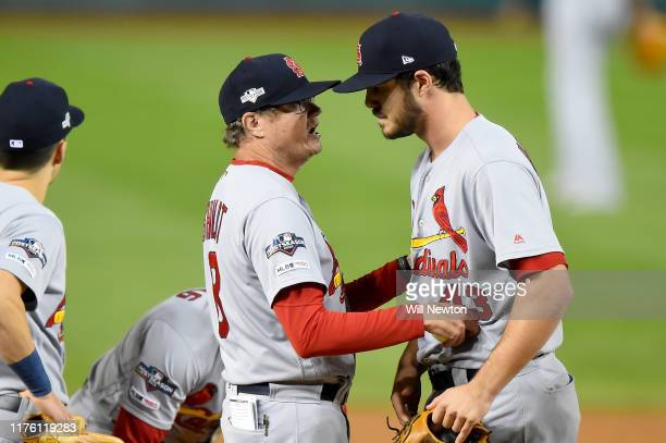 Manager Mike Shildt of the St Louis Cardinals speaks with Dakota Hudson after pulling him during the first inning of Game Four of the National League...