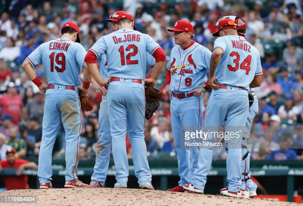 Manager Mike Shildt of the St Louis Cardinals visits the mound for a pitching change during the ninth inning of a game against the Chicago Cubs at...