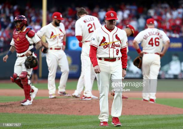 Manager Mike Shildt of the St Louis Cardinals walks back to the dug out after making a pitching change during the eighth inning of game two of the...