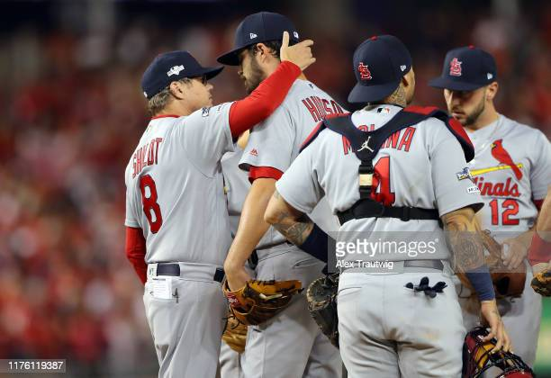 Manager Mike Shildt takes starting pitcher Dakota Hudson of the St Louis Cardinals out of the game in the bottom of the first inning of Game 4 of the...