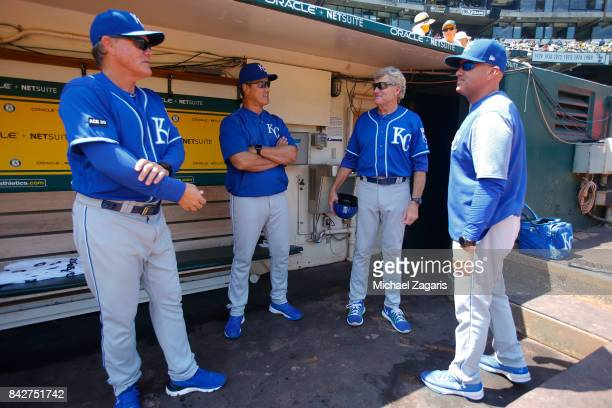 Manager Ned Yost Bench Coach Don Wakamatsu First Base Coach Rusty Kuntz and Third Base Coach Mike Jirschele of the Kansas City Royals talk in the...