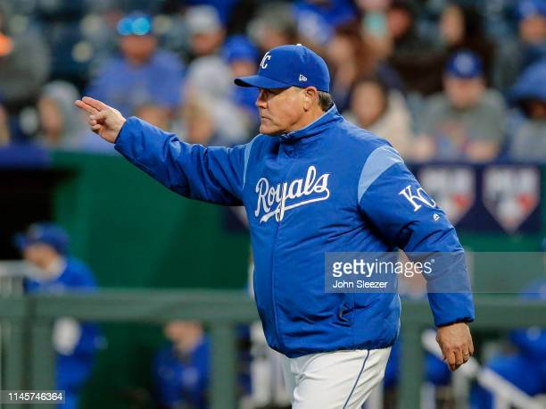 Manager Ned Yost of the Kansas City Royals calls for a right handed pitcher as he walks out to relieve starter Jorge Lopez out of the game in the...