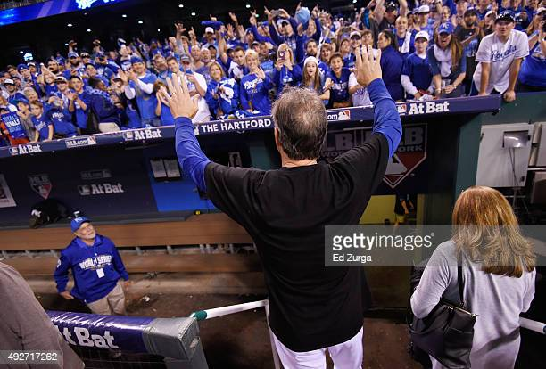Manager Ned Yost of the Kansas City Royals celebrates with fans after the Kansas City Royals defeat the Houston Astros 72 in game five of the...