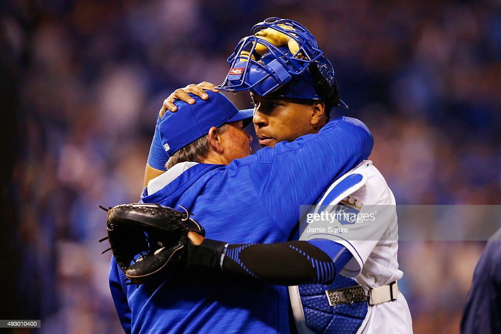 Manager Ned Yost #3 of the Kansas City Royals celebrates with Salvador Perez #13 of the Kansas City Royals after defeating the Toronto Blue Jays 5-0 in game one of the American League Championship Series at Kauffman Stadium on October 16, 2015 in Kansas City, Missouri.