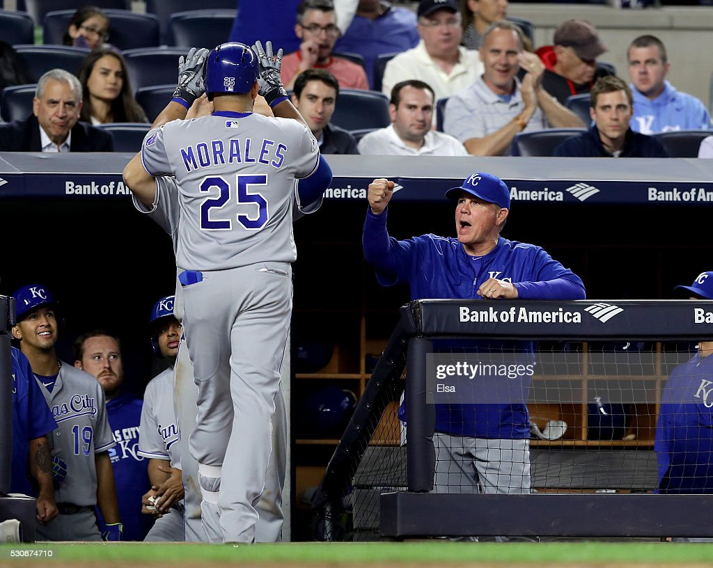 Manager Ned Yost #3 of the Kansas City Royals congratulates Kendrys Morales #25 after he hit a solo home run in the seventh inning against the New York Yankees at Yankee Stadium on May 11, 2016 in the Bronx borough of New York City.