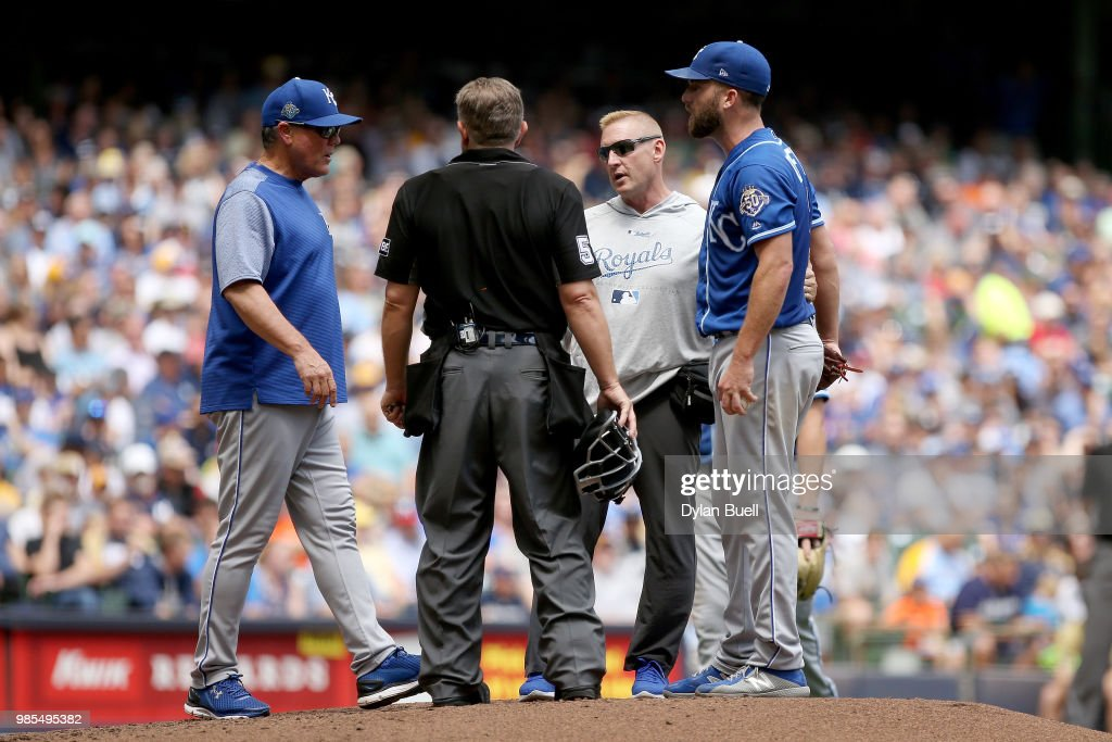 Manager Ned Yost of the Kansas City Royals meets with Danny Duffy #41 in the sixth inning against the Milwaukee Brewers at Miller Park on June 27, 2018 in Milwaukee, Wisconsin.