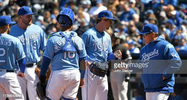 Manager Ned Yost of the Kansas City Royals relieves relief pitcher Tim Hill of the Kansas City Royals in the sixth inning after giving up two bases...