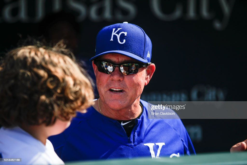 Manager Ned Yost #3 of the Kansas City Royals speaks to a young fan before the game against the Chicago Cubs at Kauffman Stadium on August 8, 2018 in Kansas City, Missouri.