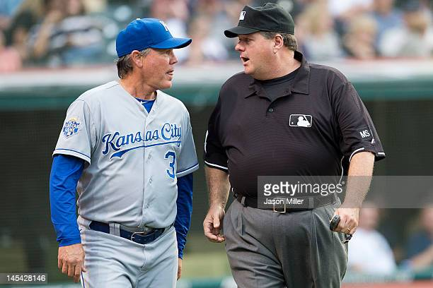 Manager Ned Yost of the Kansas City Royals talks with second base umpire Jerry Layne after Yost requested that a foul call be reviewed during the...