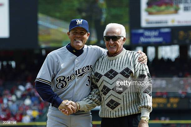 Manager Ned Yost of the Milwaukee Brewers shakes hands with radio announcer Bob Uecker, the voice of the Milwaukee Brewers since 1978, during opening...