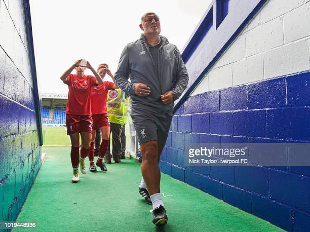 Manager Neil Redfearn of Liverpool FC Women makes his way into the tunnel after the warmup before the Liverpool FC Women v Manchester United Women...