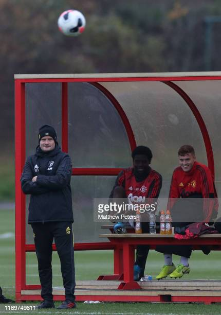 Manager Neil Ryan of Manchester United U18s watches from the dugout during the U18 Premier League match between Manchester United U18s and Brighton...