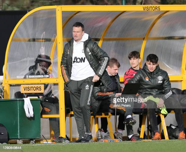 Manager Neil Ryan of Manchester United U18s watches from the dugout during the U18 Premier League match between Wolverhampton Wanderers U18s and...