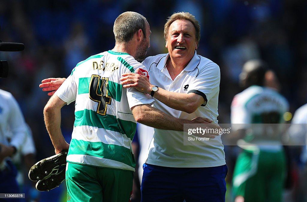 QPR manager Neil Warnock celebrates with Shaun Derry at the end of the drawn game after the npower Championship game between Cardiff City and Queens Park Rangers at Cardiff City Stadium on April 23, 2011 in Cardiff, Wales.
